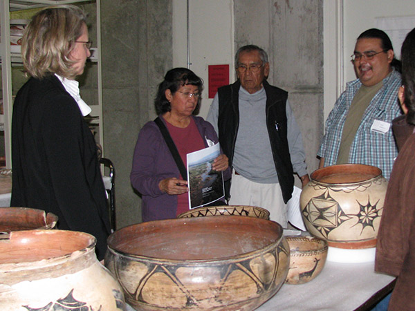 Conservators, Larry Humetewa and Landis Smith, consult with potter Martha Arquero of Cochiti Pueblo on pottery technology and conservation treatment options.